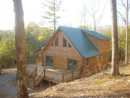 Daniel Boone Log Cabin Home Features Hardwood Floors Stainless
