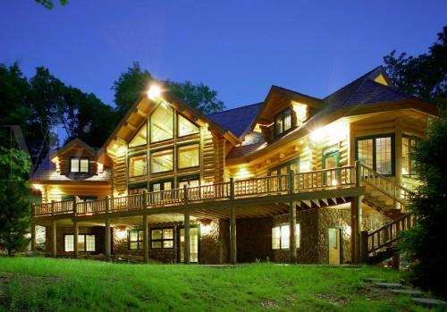 Executive Style Log Home Lights Evening