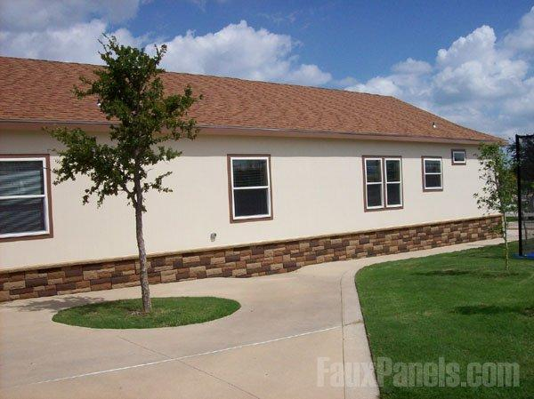 Faux Rock Siding Prevents Stucco Walls Visually Blending Into