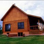 House Gives Log Home Pleasant Comfortable Look