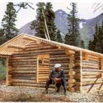 Proenneke Takes Break Building His Alaskan Log Cabin Hand