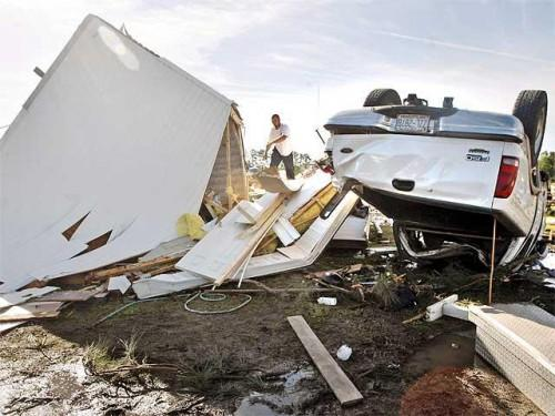 Salvage Belongings Overturned Mobile Home
